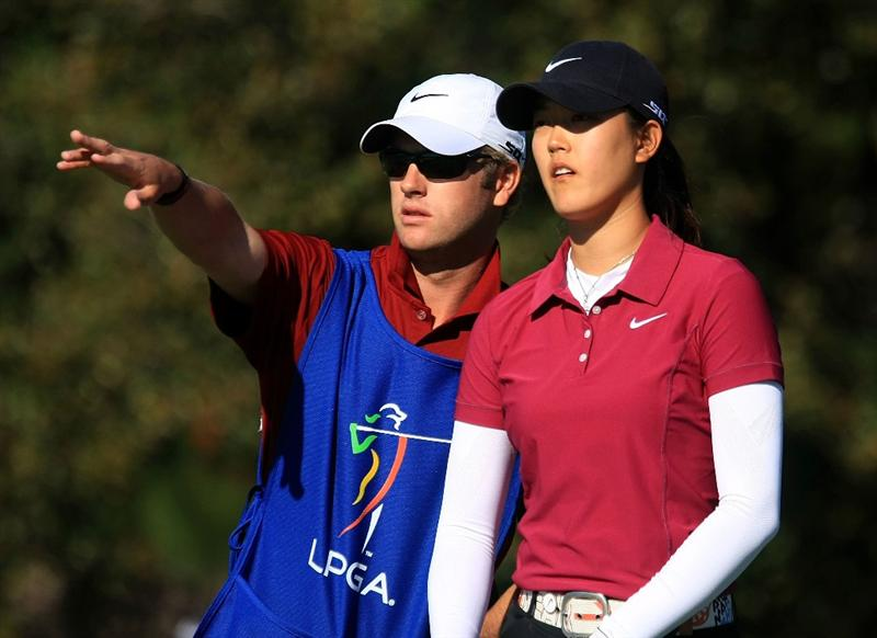 DAYTONA BEACH, FL - DECEMBER 07:  Michelle Wie chats with her caddie Tom Vickers on the 17th hole during the final round of the LPGA Qualifying School at LPGA International on December 7, 2008 in Daytona Beach, Florida.  (Photo by Scott Halleran/Getty Images)