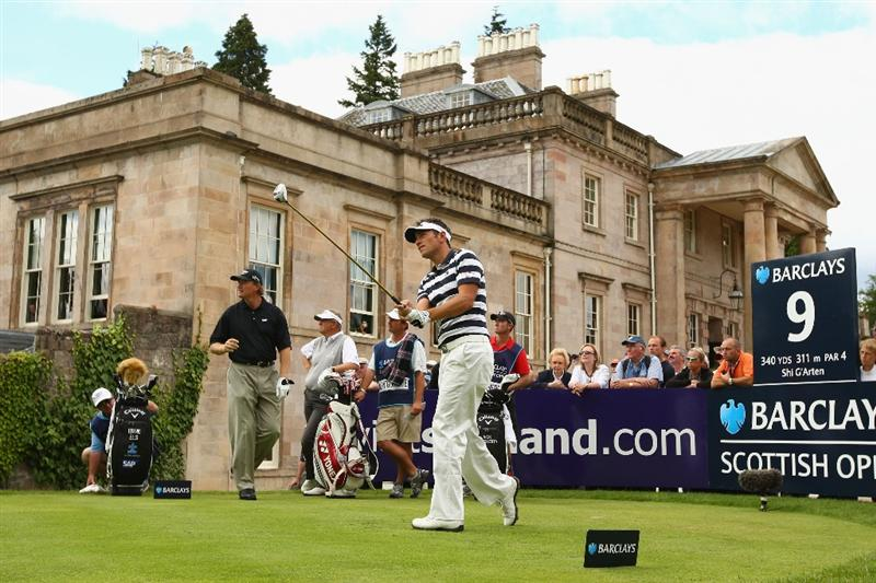LUSS, SCOTLAND - JULY 09:  Nick Dougherty of England tees off on the 9th hole during the First Round of The Barclays Scottish Open at Loch Lomond Golf Club on July 09, 2009 in Luss, Scotland.  (Photo by Richard Heathcote/Getty Images)