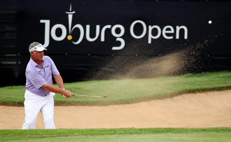 JOHANNESBURG, SOUTH AFRICA - JANUARY 13:  Darren Clarke of Northern Ireland plays out of the 18th greenside bunker during the first round of the Joburg Open at Royal Johannesburg and Kensington Golf Club on January 13, 2011 in Johannesburg, South Africa.  (Photo by Warren Little/Getty Images)