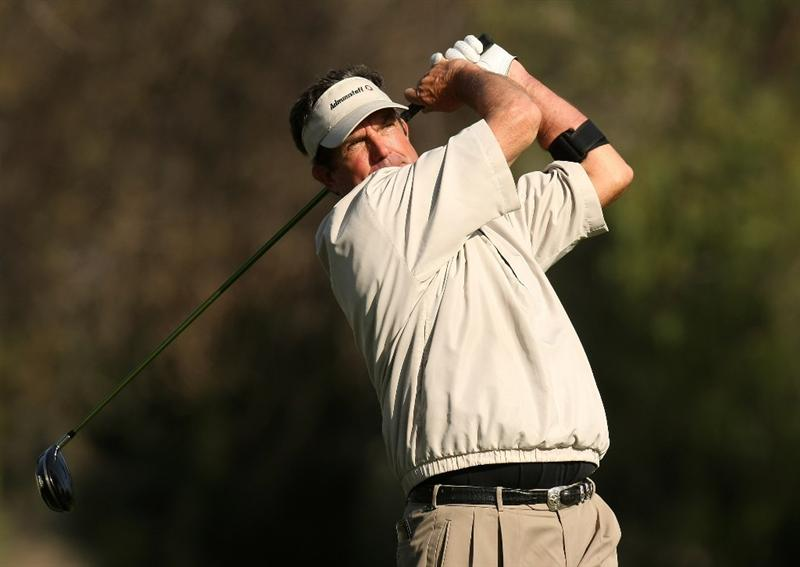 VALENCIA, CA - MARCH 14:  Bruce Lietzke hits his tee shot on the 18th hole during the second round of the AT&T Chapmpions Classic on March 14, 2009 at Valencia Country Club in Valencia, California.  (Photo by Stephen Dunn/Getty Images)