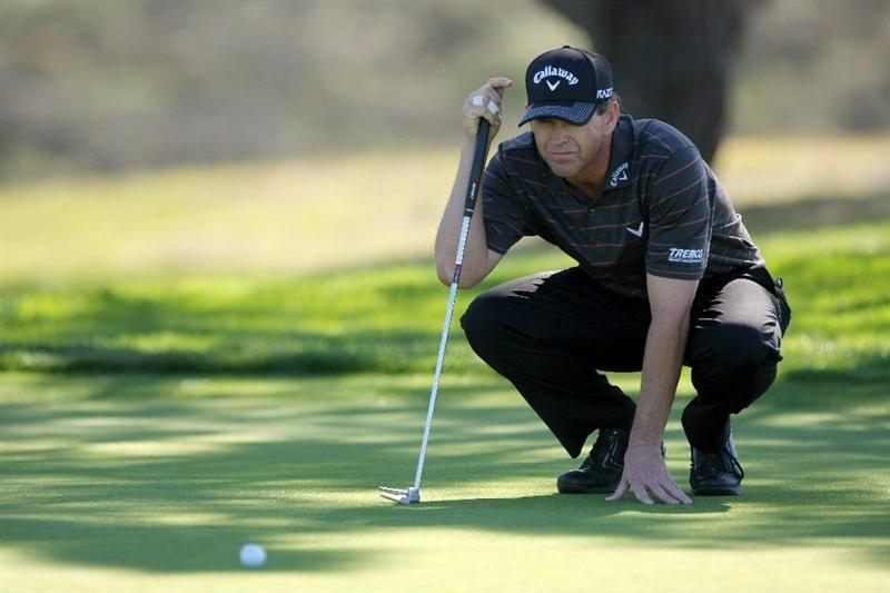 LA JOLLA, CA - JANUARY 27:  Lee Janzen lines up his putt on the 13th green during the first round of the Farmers Insurance Open at Torrey Pines on January 27, 2011 in La Jolla, California. (Photo by Donald Miralle/Getty Images)