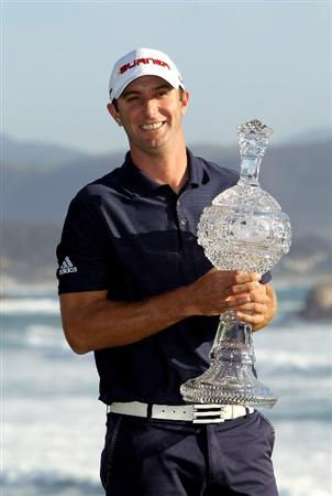 PEBBLE BEACH, CA - FEBRUARY 14:  Dustin Johnson holds the trophy after winning the AT&T Pebble Beach National Pro-Am at Pebble Beach Golf Links on February 14, 2010 in Pebble Beach, California.  (Photo by Ezra Shaw/Getty Images)