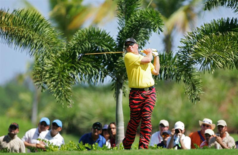 RIO GRANDE, PR - MARCH 14:  John Daly watches his drive during the continuation of the second round of the Puerto Rico Open presented by Banco Popular at Trump International Golf Club held on March 14, 2010 in Rio Grande, Puerto Rico.  (Photo by Michael Cohen/Getty Images)