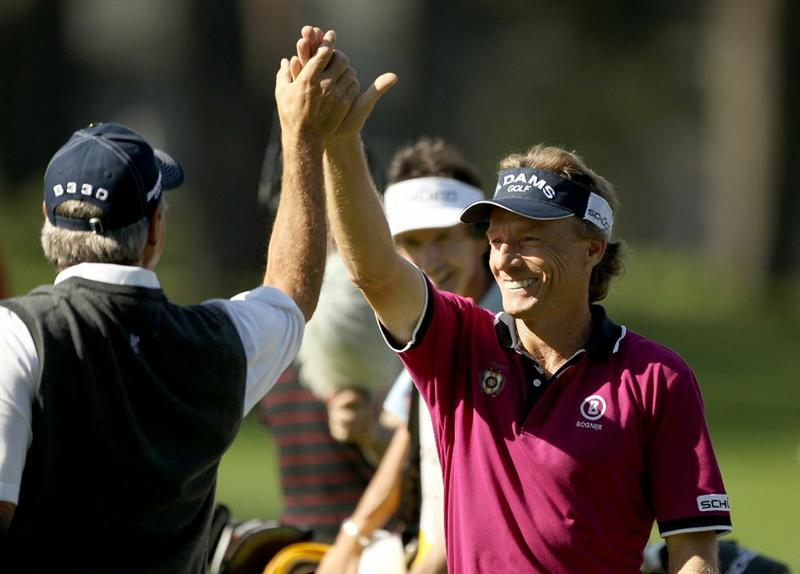 SAN FRANCISCO - NOVEMBER 04:  Bernhard Langer of Germany high fives Fred Couples of the USA after hitting a hole-in-one on the third hole of round 1 of the Charles Schwab Cup Championship at Harding Park Golf Course on November 4, 2010 in San Francisco, California.  (Photo by Ezra Shaw/Getty Images)