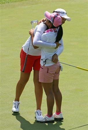 GLADSTONE, NJ - MAY 21: M.J. Hur of South Korea (L) hugs Ai Miyazato of Japan (R) after defeating her on the 18th hole during the second round of the Sybase Match Play Championship at Hamilton Farm Golf Club on May 21, 2010 in Gladstone, New Jersey. (Photo by Hunter Martin/Getty Images)