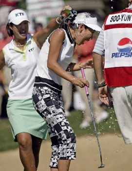Tournament champion Soo-Yun Kang reacts to getting showered by champagne by friend Birdie Kim. Kang won her first LPGA event at 15 under par. Shooting a 64, 68, 69 at the 2005 Safeway Classic held at Columbia Edgewater Country Club, Sunday,  August 21, 2005.Photo by Allan Campbell/WireImage.com