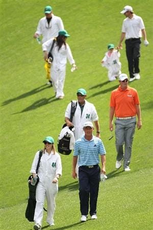 AUGUSTA, GA - APRIL 07:  Nathan Green and Marc Leishman of Australia walk with their caddies during the Par 3 Contest prior to the 2010 Masters Tournament at Augusta National Golf Club on April 7, 2010 in Augusta, Georgia.  (Photo by Jamie Squire/Getty Images)