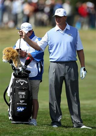 PEBBLE BEACH, CA - JUNE 19:  Ernie Els of South Africa waits with his caddie Ricci Roberts during the third round of the 110th U.S. Open at Pebble Beach Golf Links on June 19, 2010 in Pebble Beach, California.  (Photo by Ross Kinnaird/Getty Images)