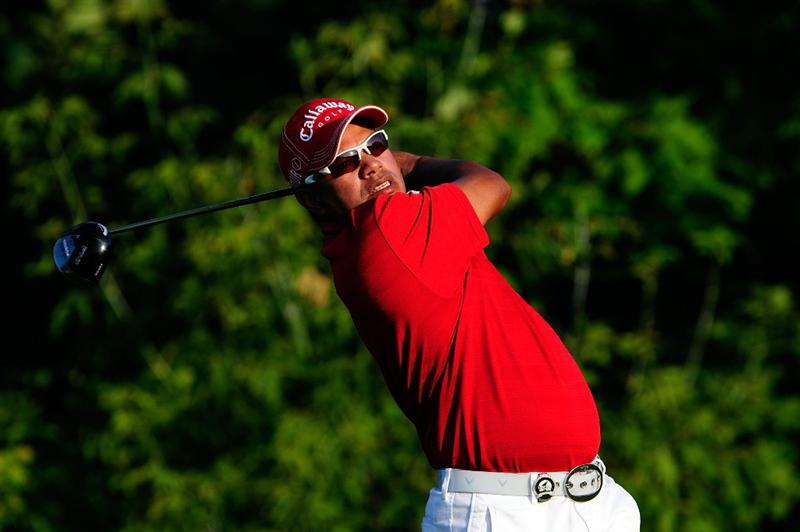CHASKA, MN - AUGUST 13:  Prayad Marksaeng of Thailand watches his tee shot on the tenth hole during the first round of the 91st PGA Championship at Hazeltine National Golf Club on August 13, 2009 in Chaska, Minnesota.  (Photo by Sam Greenwood/Getty Images)