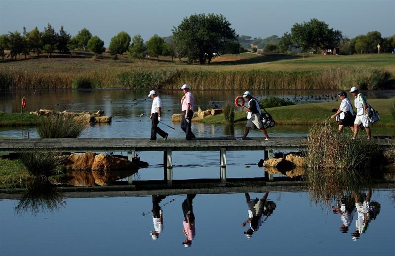 VILAMOURA, PORTUGAL - OCTOBER 15:  Paul McGinley of Ireland (far left) and Richard Finch of England (second from left) cross the bidge on the 14th hole with their caddies during the first round of the Portugal Masters at the Oceanico Victoria Golf Course on October 15, 2009 in Vilamoura, Portugal.  (Photo by Andrew Redington/Getty Images)