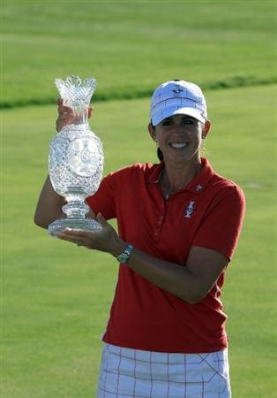 SUGAR GROVE, IL - AUGUST 23: Nicole Castrale of the USA with the trophy after the Sunday singles matches at the 2009 Solheim Cup Matches, at the Rich Harvest Farms Golf Club on August 23, 2009 in Sugar Grove, Ilinois (Photo by David Cannon/Getty Images)