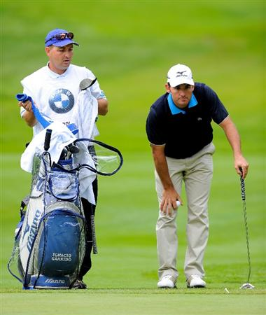 TURIN, ITALY - MAY 08:  Ignacio Garrido of Spain and caddie line up his putt on the 15th hole during the third round of the BMW Italian Open at Royal Park I Roveri on May 8, 2010 in Turin, Italy.  (Photo by Stuart Franklin/Getty Images)