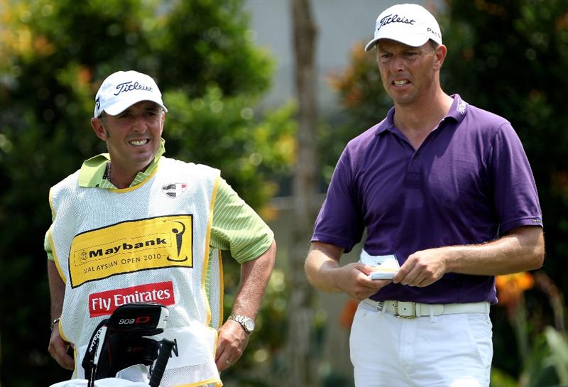 KUALA LUMPUR, MALAYSIA - MARCH 05:  Soren Hansen of Denmark waits with his caddie Phil 'Wobbly' Morbey on the ninth hole during the second round of the Maybank Malaysia Open at the Kuala Lumpur Golf & Country on March 5, 2010 in Kuala Lumpur, Malaysia.  (Photo by Ross Kinnaird/Getty Images)