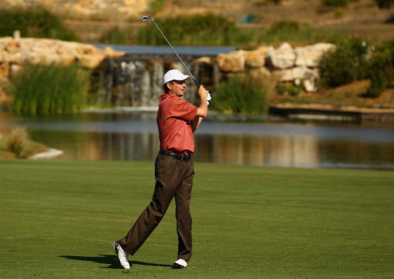 VILAMOURA, PORTUGAL - OCTOBER 17:  Peter Lawrie of Ireland plays into the 7th green during the final round of the Portugal Masters at the Oceanico Victoria Golf Course on October 17, 2010 in Vilamoura, Portugal.  (Photo by Richard Heathcote/Getty Images)