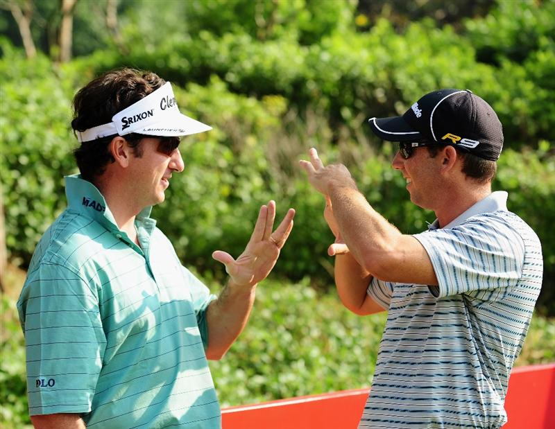 SHENZHEN, GUANGDONG - NOVEMBER 25:  Sergio Garcia and teamate Gonzalo Fernandez - Castano of Spain during pro - am the Omega Mission Hills World Cup on the Olazabal course on November 25, 2009 in Shenzhen, China.  (Photo by Stuart Franklin/Getty Images)