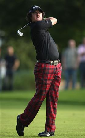 LUSS, SCOTLAND - JULY 09:  Rory McIlroy of Northern Ireland hits an approach shot on the 11th hole during the First Round of The Barclays Scottish Open at Loch Lomond Golf Club on July 09, 2009 in Luss, Scotland.  (Photo by Warren Little/Getty Images)