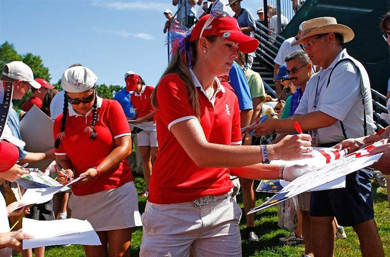 SUGAR GROVE, IL - AUGUST 18:  (R-L) Paula Creamer (3rd R) and Christina Kim(L)  of the U.S. Team sign autographs for fans during a practice round prior to the start of the 2009 Solheim Cup at Rich Harvest Farms on August 18, 2009 in Sugar Grove, Illinois.  (Photo by Scott Halleran/Getty Images)