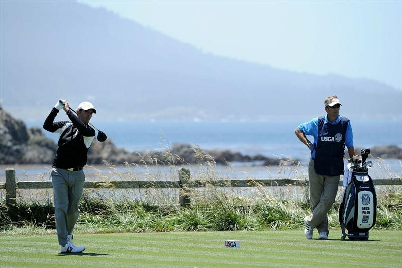PEBBLE BEACH, CA - JUNE 17:  Mike Weir of Canada hits his tee shot on the 18th hole as his caddie Brendon Little looks on during the first round of the 110th U.S. Open at Pebble Beach Golf Links on June 17, 2010 in Pebble Beach, California.  (Photo by Harry How/Getty Images)