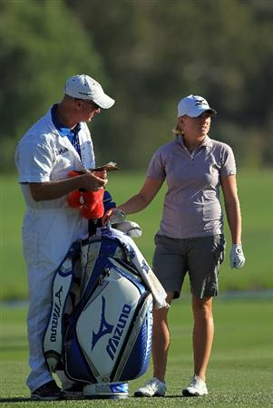 RANCHO MIRAGE, CA - APRIL 03:  Stacy Lewis of the USA plays her second shot with her caddie Travis Wilson on the par 5, 18th hole during the final round of the 2011 Kraft Nabisco Championship on the Dinah Shore Championship Course at the Mission Hills Country Club on April 3, 2011 in Rancho Mirage, California.  (Photo by David Cannon/Getty Images)