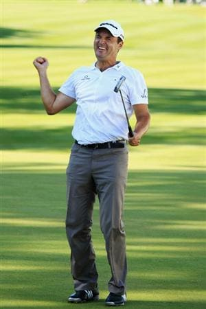 VIRGINIA WATER, ENGLAND - MAY 23:  Simon Khan of England celebrates becoming the leader in the clubhouse on the 18th green during the final round of the BMW PGA Championship on the West Course at Wentworth on May 23, 2010 in Virginia Water, England.  (Photo by Warren Little/Getty Images)