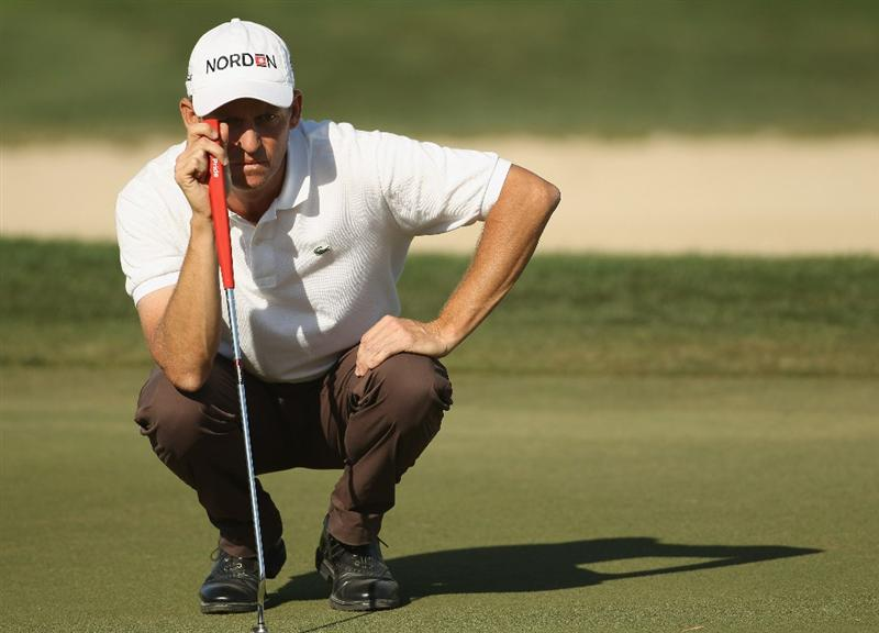 DUBAI, UNITED ARAB EMIRATES - FEBRUARY 12:  Anders Hansen of Denmark lines up a put during the third round for the 2011 Omega Dubai desert Classic held on the Majilis Course at the Emirates Golf Club on February 12, 2011 in Dubai, United Arab Emirates.  (Photo by Ian Walton/Getty Images)