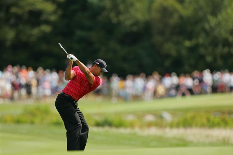NORTON, MA - SEPTEMBER 07:  Tiger Woods hit  his second shot on the second hole during the final round of the Deutsche Bank Championship at TPC Boston held on September 7, 2009 in Norton, Massachusetts.  (Photo by Michael Cohen/Getty Images)