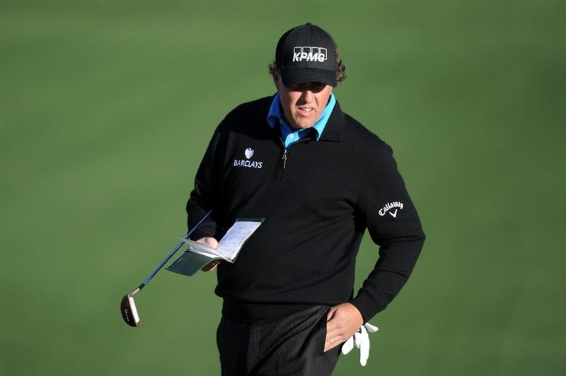 AUGUSTA, GA - APRIL 06:  Phil Mickelson looks over a green during a practice round prior to the 2011 Masters Tournament at Augusta National Golf Club on April 6, 2011 in Augusta, Georgia.  (Photo by Harry How/Getty Images)