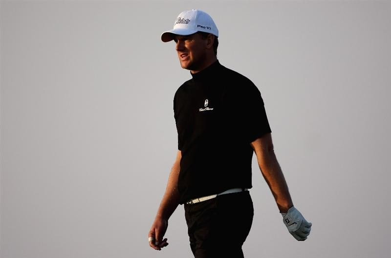 DOHA, QATAR - JANUARY 23:  Robert Karlsson of Sweden walks towards his ball on the 18th hole during the second round of  the Commercialbank Qatar Masters at Doha Golf Club on January 23, 2009 in Doha, Qatar.  (Photo by Andrew Redington/Getty Images)