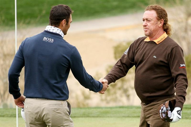 MARANA, AZ - FEBRUARY 26:  Miguel Angel Jimenez of Spain (R) congratulates Martin Kaymer of Germany (L) on his win on the 18th hole during the quarterfinal round of the Accenture Match Play Championship at the Ritz-Carlton Golf Club on February 26, 2011 in Marana, Arizona.  (Photo by Andy Lyons/Getty Images)