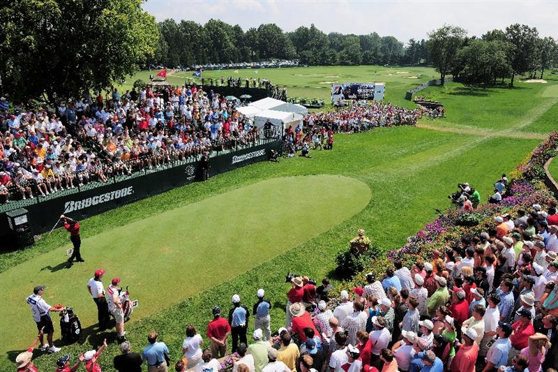 AKRON, OH - AUGUST 09:  Tiger Woods of USA plays his tee shot on the first hole during the final round of the World Golf Championship Bridgestone Invitational on August 9, 2009 at Firestone Country Club in Akron, Ohio.  (Photo by Stuart Franklin/Getty Images)