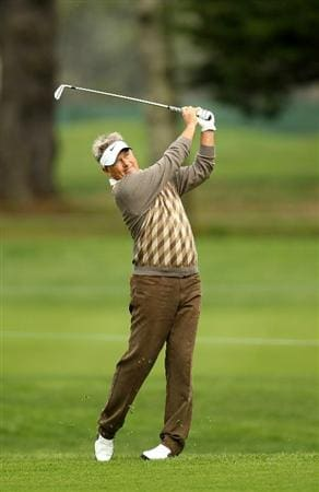 SAN FRANCISCO - NOVEMBER 05:  John Cook hits his approach shot on the 2nd hole during round 2 of the Charles Schwab Cup Championship at Harding Park Golf Course on November 5, 2010 in San Francisco, California.  (Photo by Ezra Shaw/Getty Images)