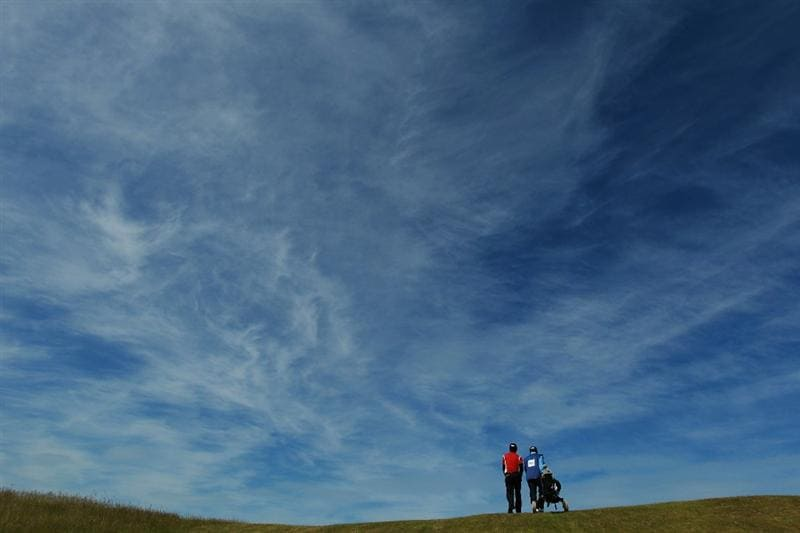 GULLANE, SCOTLAND - JUNE 18:  Jin Jeong of Korea walks with his caddie up the 11th fairway during the semi final match against Matthew Nixon of England for The Amateur Championship at Muirfield Golf Club on June 18, 2010 in Gullane, Scotland.  (Photo by Warren Little/Getty Images)