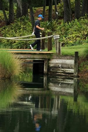 PONTE VEDRA BEACH, FL - MAY 15:  Justin Rose of England walks over the bridge on the 16th hole during the continuation of the third round of THE PLAYERS Championship held at THE PLAYERS Stadium course at TPC Sawgrass on May 15, 2011 in Ponte Vedra Beach, Florida.  (Photo by Mike Ehrmann/Getty Images)