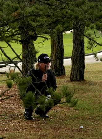 PEBBLE BEACH, CA - FEBRUARY 13: Charley Hoffman lines up up a shot from the trees on the 11th hole at Poppy Hills Golf Course during the second round of the the AT&T Pebble Beach National Pro-Am on February 13, 2009 in Pebble Beach, California. (Photo by Stephen Dunn/Getty Images)
