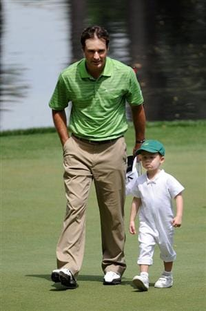 AUGUSTA, GA - APRIL 07:  Trevor Immelman walks across a green with his son Jacob during the Par 3 Contest prior to the 2010 Masters Tournament at Augusta National Golf Club on April 7, 2010 in Augusta, Georgia.  (Photo by Harry How/Getty Images)