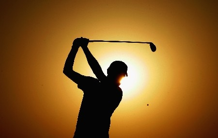 NEW DELHI, INDIA - FEBRUARY 29:  Gregory Bourdy of France plays his shot into the setting sun during the second round of the 2008 Johnnie Walker Classic held at The DLF Golf and Country Club on February 29, 2008 in New Delhi, India.  (Photo by Warren Little/Getty Images)