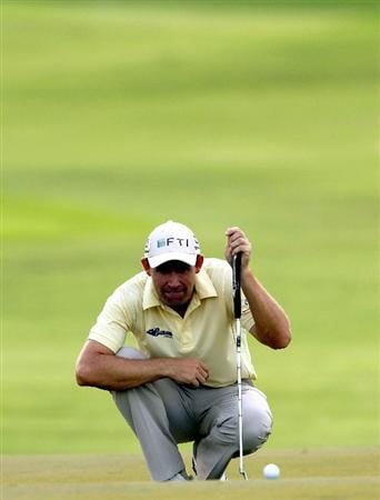 SINGAPORE - NOVEMBER 12:  Padraig Harrington of Ireland lines up for a putt on the 12th hole during the second round of the Barclays Singapore Open held at the Sentosa Golf Club on November 12, 2010 in Singapore, Singapore.  (Photo by Stanley Chou/Getty Images)