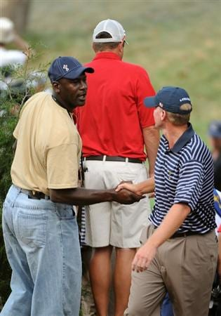 LOUISVILLE, KY - SEPTEMBER 20:  Basketball great Michael Jordan shakes hands with Steve Stricker of the USA team during the afternoon four-ball matches on day two of the 2008 Ryder Cup at Valhalla Golf Club on September 20, 2008 in Louisville, Kentucky.  (Photo by Harry How/Getty Images)