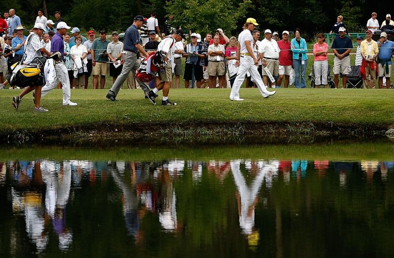 ST. LOUIS - SEPTEMBER 07: (L-R) Anthony Kim, Jim Furyk, and Camilo Villegas walk to the 3rd green during the final round of the BMW Championship on September 7, 2008 at Bellerive Country Club in St. Louis, Missouri.  (Photo by Mike Ehrmann/Getty Images)
