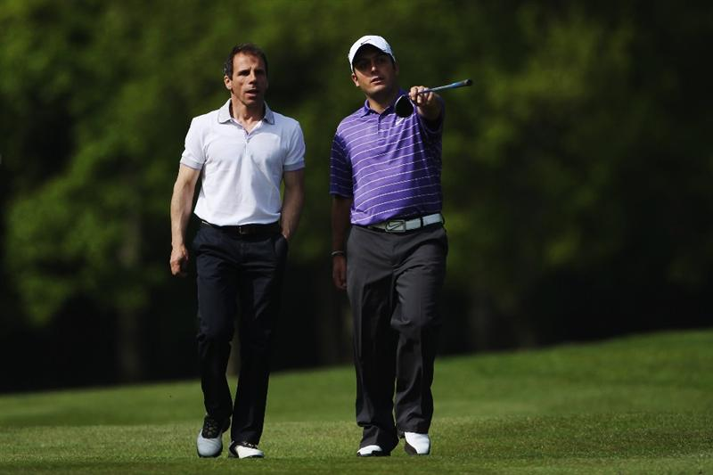 VIRGINIA WATER, ENGLAND - MAY 19:  Former footballer and ex West Ham United manager Gianfranco Zola (L) takes some advice from Francesco Molinari of Italy during the Pro-Am round prior to the BMW PGA Championship on the West Course at Wentworth on May 19, 2010 in Virginia Water, England.  (Photo by Andrew Redington/Getty Images)