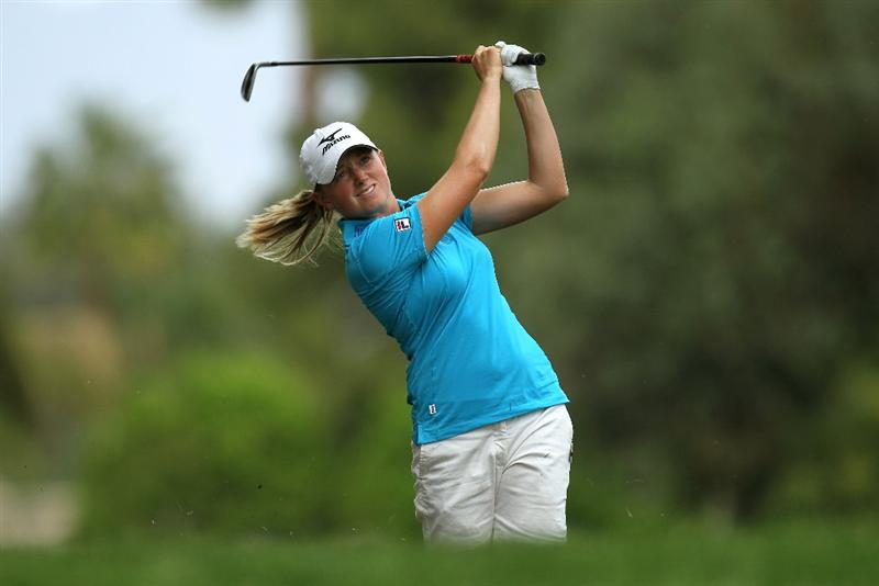 RANCHO MIRAGE, CA - APRIL 02:  Stacy Lewis hits her second shot on the 11th hole during the third round of the Kraft Nabisco Championship at Mission Hills Country Club on April 2, 2011 in Rancho Mirage, California.  (Photo by Stephen Dunn/Getty Images)