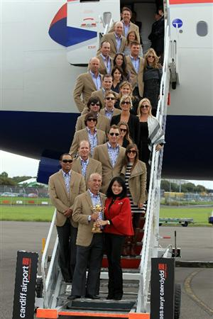 CARDIFF, WALES - SEPTEMBER 27:  In this handout image provided by Ryder Cup Europe, USA team captain Corey Pavin and the USA team pose with their wives and partners after arriving at Cardiff Airport prior to the start of the 2010 Ryder Cup on September 27, 2010 in Cardiff, Wales.  (Photo by Ryder Cup Europe via Getty Images)