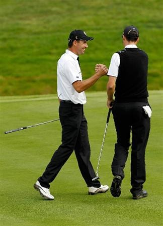 NEWPORT, WALES - OCTOBER 02:  Ross Fisher (R) and Padraig Harrington of Europe celebrate on the 15th green during the rescheduled Afternoon Foursome Matches during the 2010 Ryder Cup at the Celtic Manor Resort on October 2, 2010 in Newport, Wales. (Photo by Sam Greenwood/Getty Images)