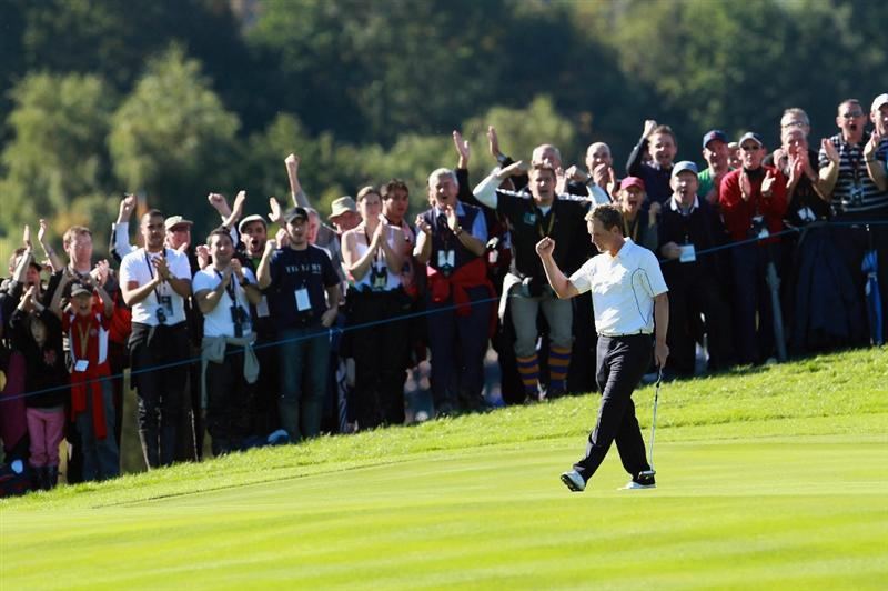 NEWPORT, WALES - OCTOBER 04:  Luke Donald of Europe celebrates holing a putt on the 12th green in the singles matches during the 2010 Ryder Cup at the Celtic Manor Resort on October 4, 2010 in Newport, Wales. (Photo by Andrew Redington/Getty Images)