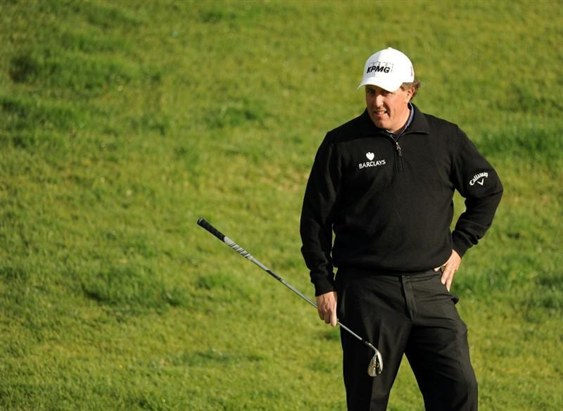 PACIFIC PALISADES, CA - FEBRUARY 18:  Phil Mickelson waits to play from the rough on the second hole during the second round of the Northern Trust Open at the Riviera Country Club on February 18, 2011 in Pacific Palisades, California.  (Photo by Harry How/Getty Images)