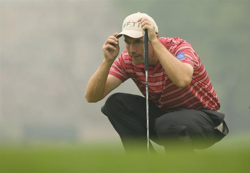 CHENGDU, CHINA - APRIL 21:  Padraig Harrington of Ireland lines up a putt during first round of the Volvo China Open at Luxehills Country Club on April 21, 2011 in Chengdu, China.  (Photo by Ian Walton/Getty Images)