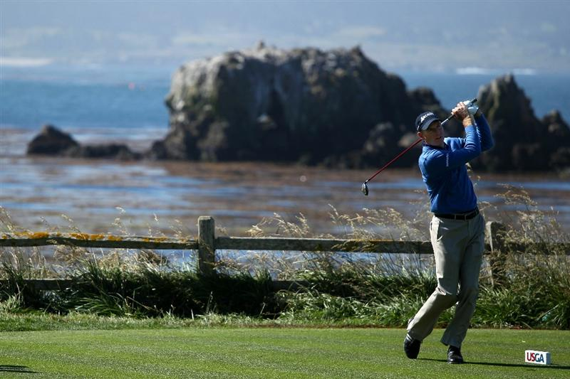 PEBBLE BEACH, CA - JUNE 17:  Jim Furyk hits his shot on the 18th hole during the first round of the 110th U.S. Open at Pebble Beach Golf Links on June 17, 2010 in Pebble Beach, California.  (Photo by Andrew Redington/Getty Images)