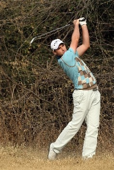 DELHI, INDIA - FEBRUARY 08:  Oliver Wilson of England hits his second shot at the 10th hole during the second round of the Emaar-MGF Indian Masters at the Delhi Golf Club, on February 8, 2008 in Delhi, India.  (Photo by David Cannon/Getty Images)