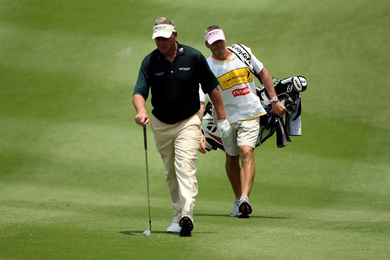 KUALA LUMPUR, MALAYSIA - MARCH 05:  Darren Clarke of Northern Ireland and his caddie approach the ninth green during the second round of the Maybank Malaysia Open at the Kuala Lumpur Golf & Country on March 5, 2010 in Kuala Lumpur, Malaysia.  (Photo by Ross Kinnaird/Getty Images)