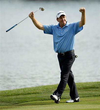 CARMEL, IN - AUGUST 02:  Fred Funk of the USA celebrates as he walks up the fairway on the 18th hole on his way toward winning the 2009 U.S. Senior Open on August 2, 2009 at Crooked Stick Golf Club in Carmel, Indiana.  (Photo by Jamie Squire/Getty Images)